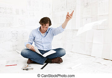 Engineer checking drawings