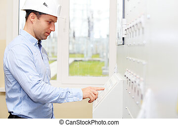 Engineer checking energy system parameters
