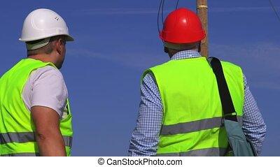 Engineer checks electrician work