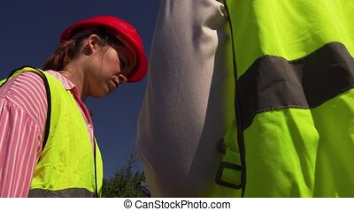 Engineer Communicates With Construction Director - Young...