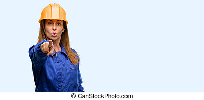 Engineer construction worker woman pointing to the front with finger