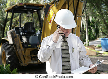 Engineer Discussing Plans - An engineer on a construction...
