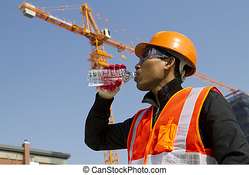 Engineer drinking water