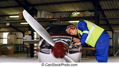 Engineer examining aircraft 4k - Engineer examining aircraft...