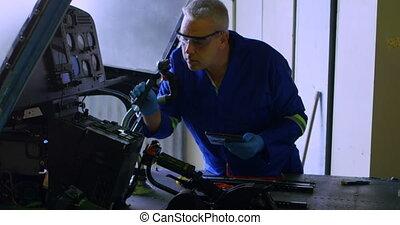Engineer examining aircraft using digital tablet 4k