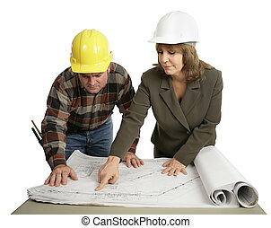 Engineer Explaining The Job - A female engineer going over...