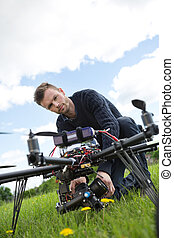 Engineer Fixing Camera On UAV Helicopter