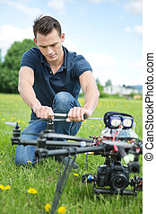 Engineer Fixing Propeller Of UAV Drone - Young engineer...