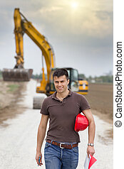 Engineer for road construction on site