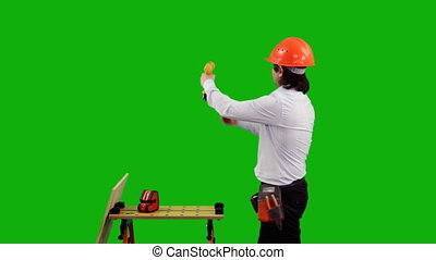 Engineer. Green screen - Handsome engineer thumbing up near...