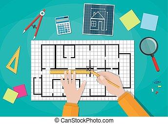 Engineer hands working on blueprint