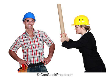 Engineer hitting a construction worker over the head
