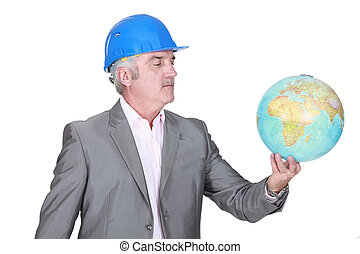 Engineer holding a globe