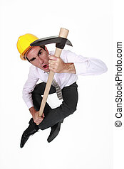 Engineer holding a pickax
