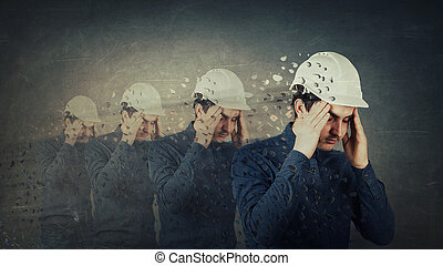 Concept of memory loss - Engineer holding arms to head...