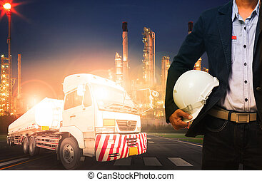 engineer holding hard hat standing against beautiful lighting of