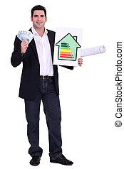 Engineer holding money and an energy efficiency rating sign
