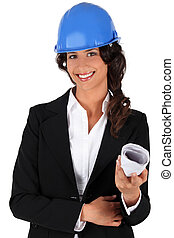 Engineer holding rolled up plans
