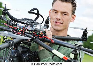 Engineer Holding UAV Octocopter