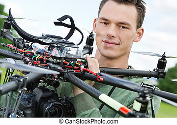 Engineer Holding UAV Octocopter