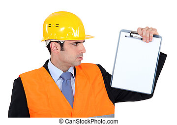 Engineer holding up a blank clipboard