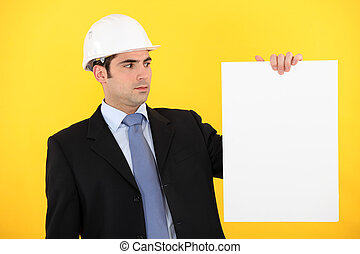 Engineer holding up a blank sign