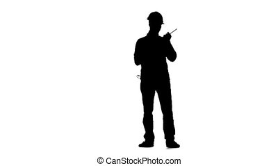 Engineer in a helmet works as a drill. Silhouette. White...