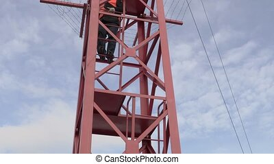 Engineer in the tower call for workers
