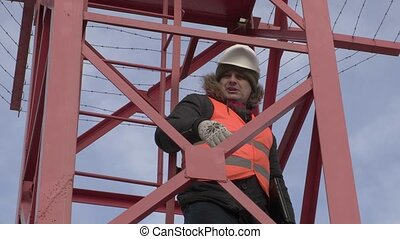 Engineer in the tower talking with workers