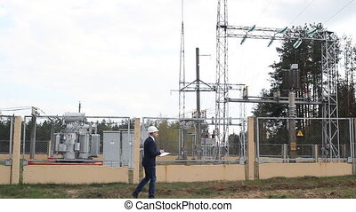 engineer inspector inspects the power station - engineer...