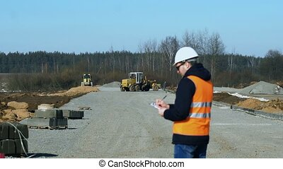 Engineer inspector looks and writes data during a phase of...