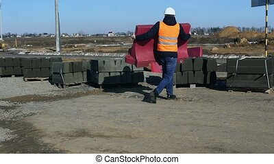 Builder cleans Water Sand Filled Barrier buffer due to repair or road construction