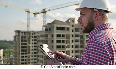 engineer looking on project on construction site