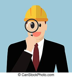 Engineer looking through a magnifying glass