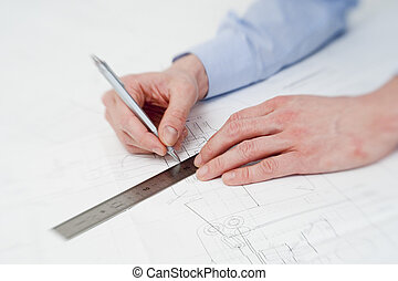 Engineer making adjustments in a drawing - hands of a...