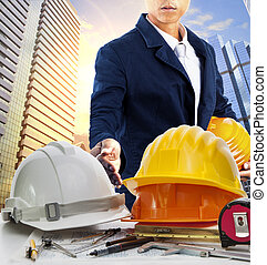 engineer man and working table against sky scrapper in urban scene use for land development and architecture occupation theme