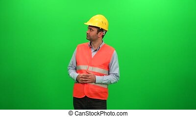 Engineer Man Looking Around Examining Construction Activity on Green Screen Background