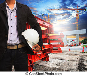 engineer man with safety helmet working in road and bridge const