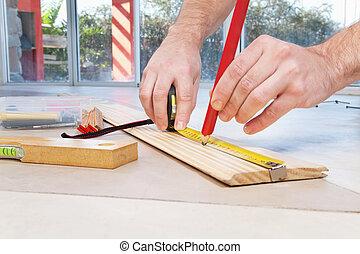 Engineer marking on plywood