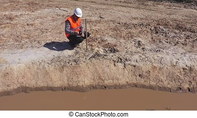 Engineer near new ditch