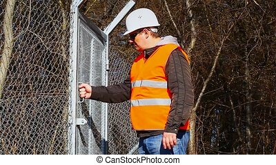 Engineer near to the fence