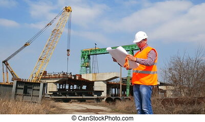 Engineer of a construction company with documents