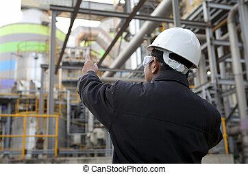 engineer oil refinery - oil refinery engineer pointing...