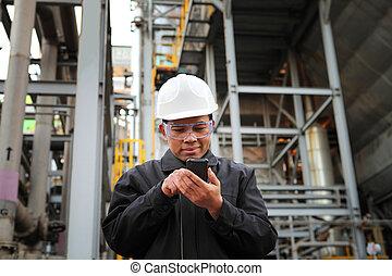 engineer oil refinery communicate via mobile phone