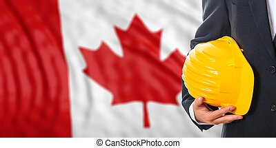 Engineer on a Canada flag background. 3d illustration