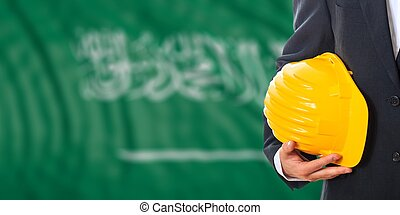 Engineer on a KSA flag background. 3d illustration -...