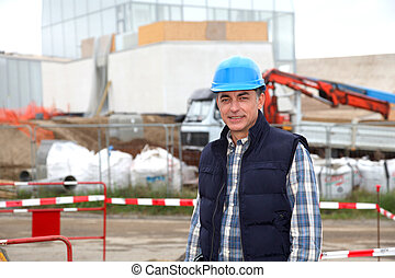 Engineer on construction site with security helmet