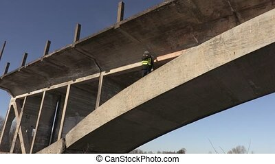 Engineer on the bridge talking with worker