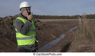 Engineer on the field near ditch