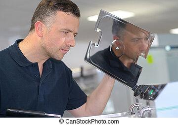 engineer opening industrial process tank
